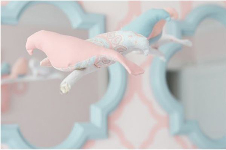 Nursery accents in pale pink and blue