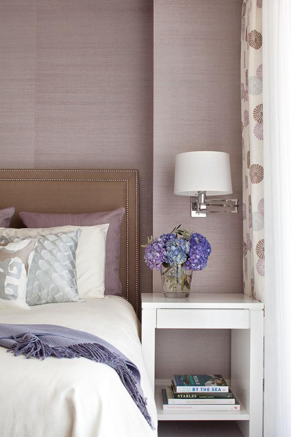 Mauve bedroom with subtle patterned wallpaper