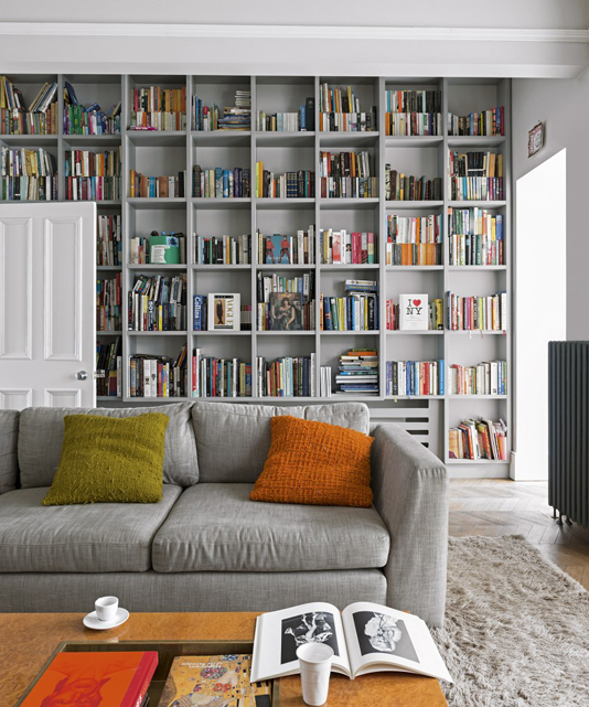 Living room with bookcase feature wall
