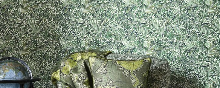 green nd white wallpaper with gold and black cushions