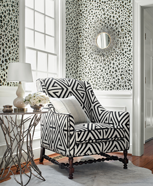 Black and white living area with geometric and animal print patterns