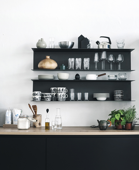Black painted shelves in kitchen
