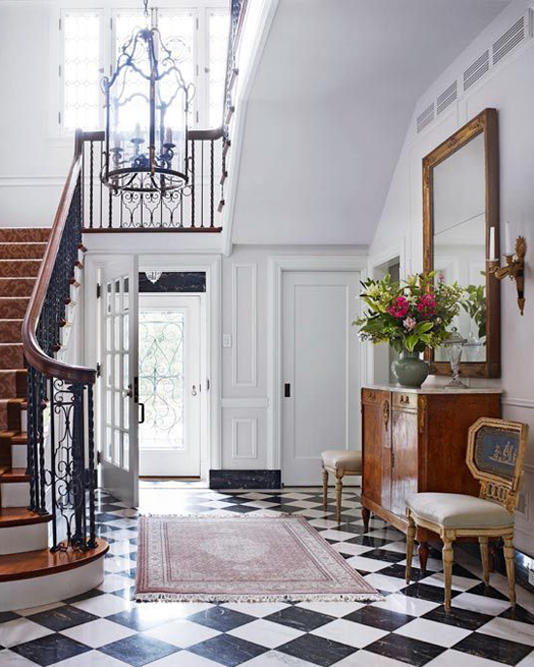 Black and white traditional hallway with brown accents