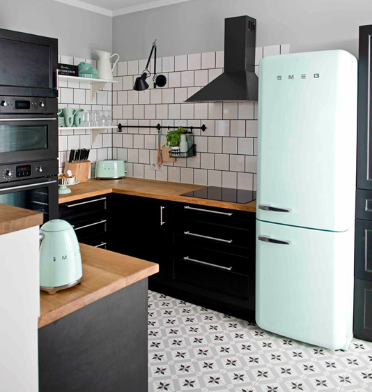 Black and white kitchen with mint green accents