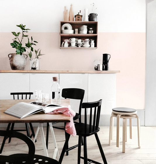 Black and white dining room with blush pink accents