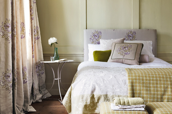 Country cottage bedroom with mauve accents