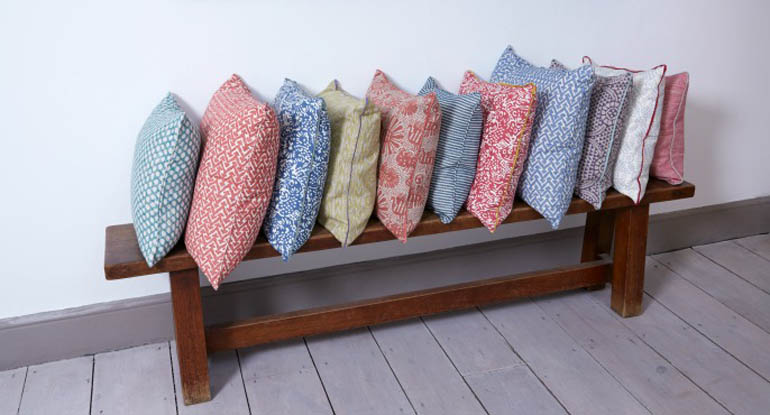 row of patterned cushion, red, green, blue, yello