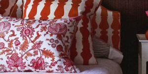 red and white chack headboard with red and white floral cushion