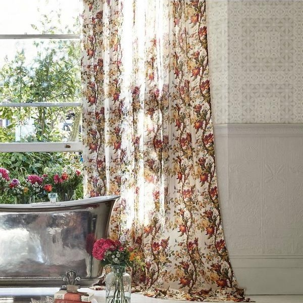 White curtain with red floral pattern  and free standing silver bath