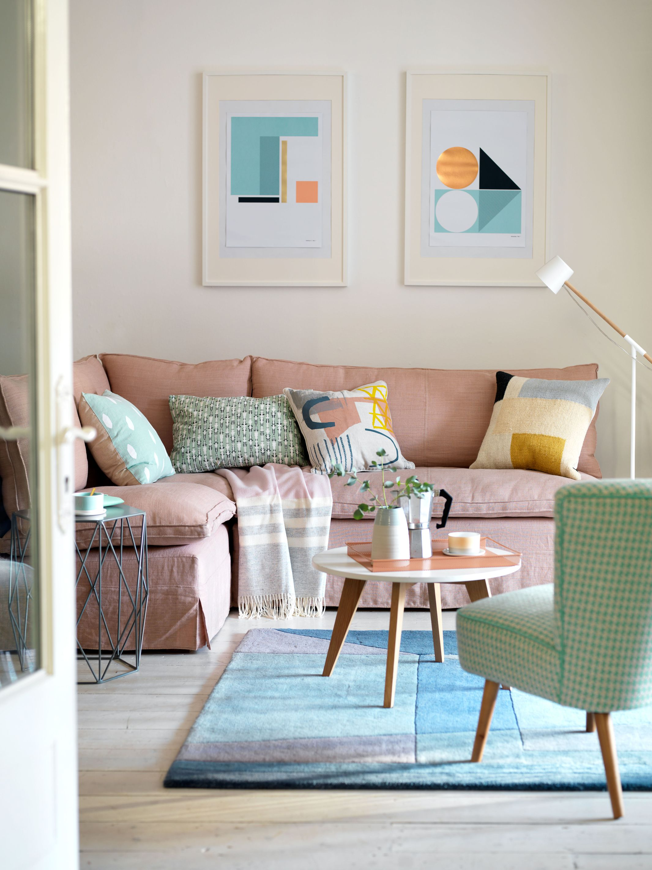 Pink Corner Sofa and Pastel Cushions