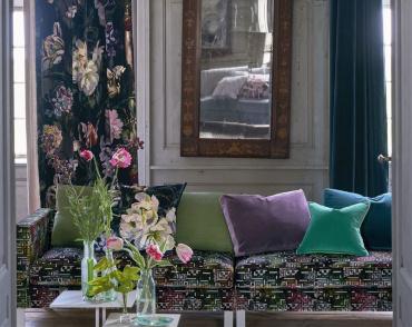 Sitting room with floral velvet curtains, plain velvet cushions and a striped velvet sofa
