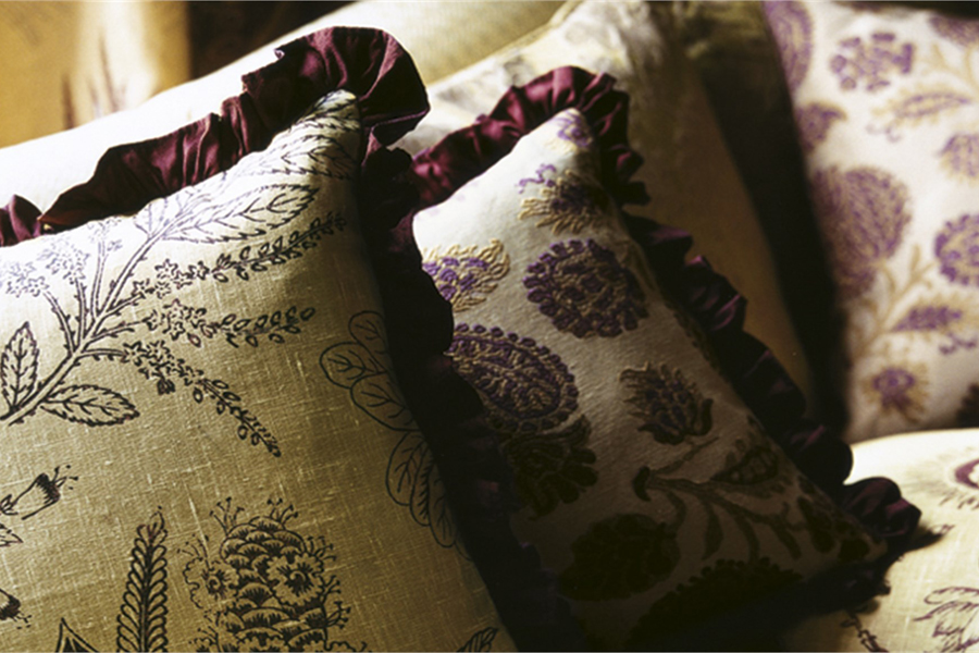 Cushions with aubergine trim