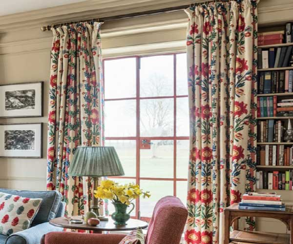 White floral curtains with red and blue floral design