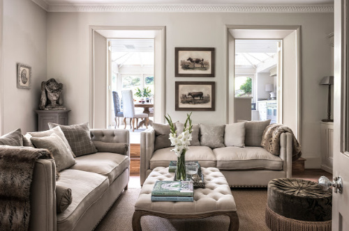neutral linen upholstered sofa and footstool
