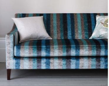 Blue and grey vertical striped velvet sofa