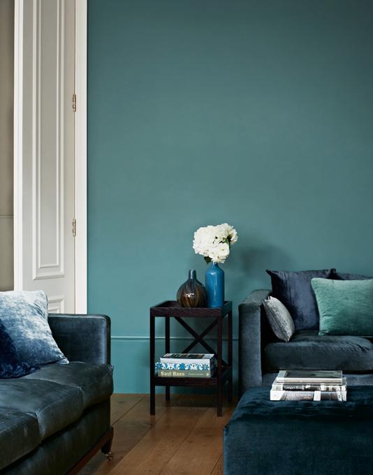 Teal living room with opulent velvet sofa