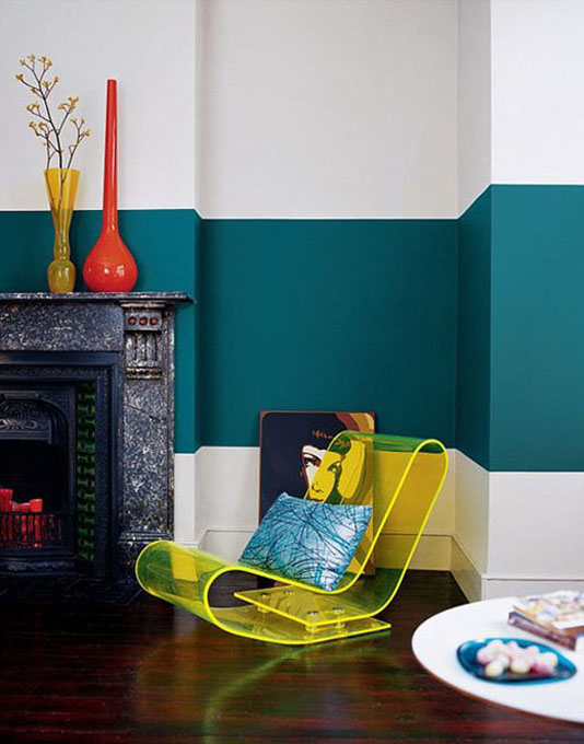 Retro living space with teal painted wall