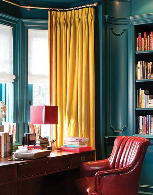Teal study with mustard yellow curtains