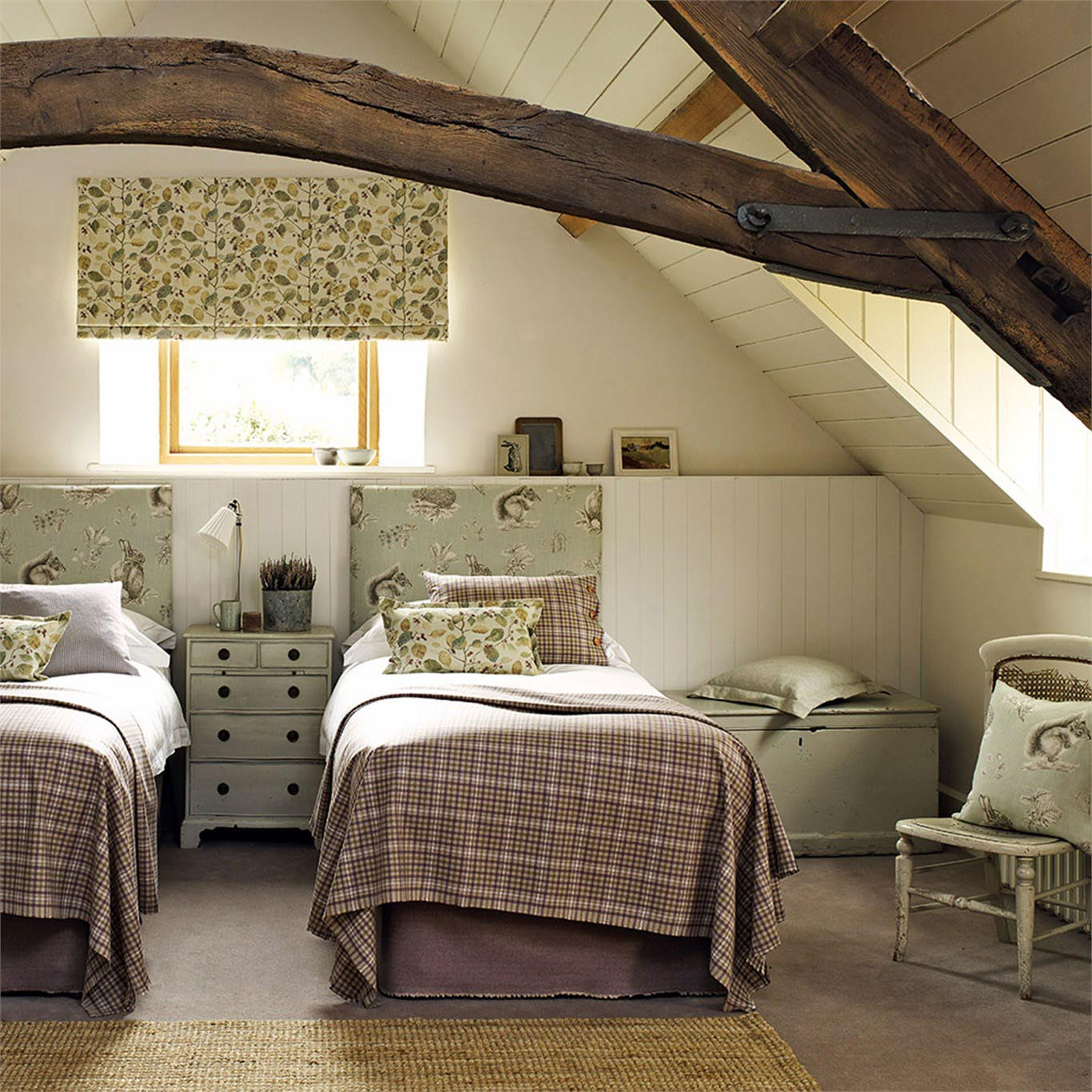 Attic bedroom with two beds, upholstered headboards