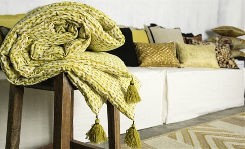 yellow and gold tasseled throw