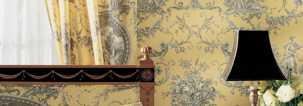 yellow and white toile wallpaper with matiching fabric cushions and lampshade
