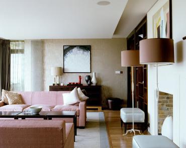 Blush pink velvet sofa in a sliver and neutral living room