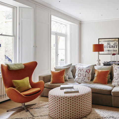 White and burnt orange living room scheme